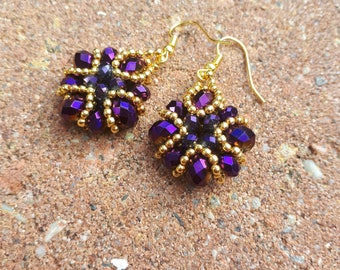 Unique handmade baroque earrings made of metallic purple facetted beads and gold seedbeads.