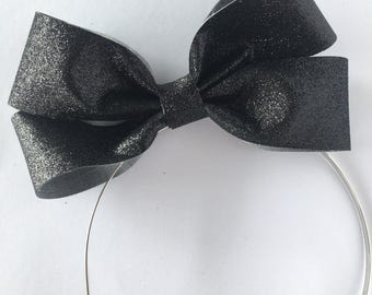 Black glitter bow hard metal headband with rubber tips
