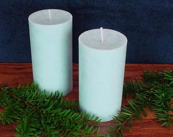 Pair of light blue cylinder shaped palm wax pillar candles