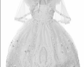 Pretty baptism dress with off shoulder sleeves and Virgin Mary embroidered on the bodiceEach ruffle of the skirt has two layers, sparkly tul