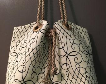 Calligraphy Print Squash Blossom Bag