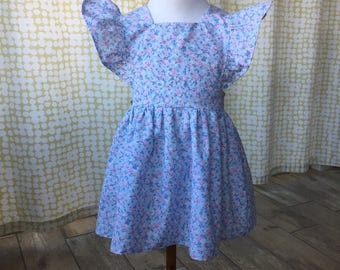 Vintage pattern pinafore with vintage novelty print fabric size 2