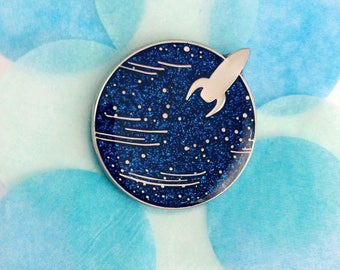 Little Planet enamel pin - sparkly blue glitter planet with rocket landing. Cute science pin, blue planet geeky pin