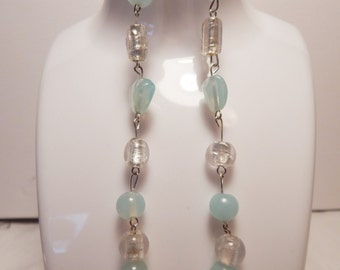 Fashion Earrings, with pale blue stones...