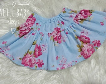 Twirly Skirt - Blue background with large pink flowers