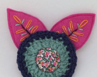 Crochet and felt flower brooch with embroidery leaves and liberty fabric button center