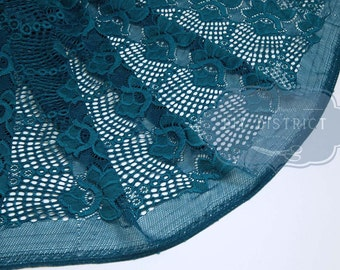 Blue duck lace fabric stretch.