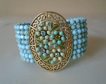 Monet bracelet blue beads gold tone with beaded paste stones flowers enamel leaves
