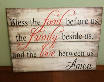 Bless the food before us, the family beside us, the love between us. Amen hand painted wood sign