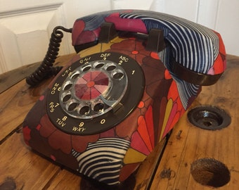 Old telephone dial vintage, old phone retro antique roulette table with Brown fabric with flowers pattern