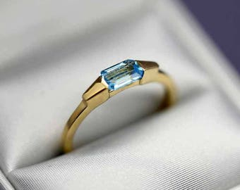 Ring 18k solid yellow gold set with a blue Topaz 0.65 ct Total weight 2.04g US size 6.75
