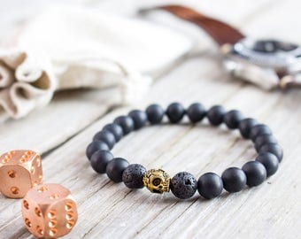 8mm - Matte black onyx and lava stone beaded stretchy bracelet with gold skull, custom made yoga bracelet, mens bracelet, womens bracelet