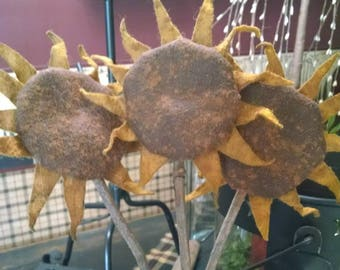 primitive sunflower made of wool felt grunged with cinn ,on a stick 14 '' tall flower is 3to 4 '' wide price is 7.95 each