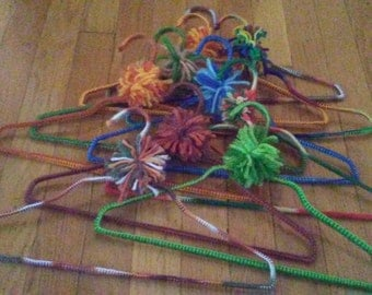 vintage yarn covered crochet clothes hangers  total of 10