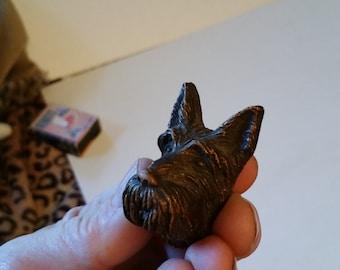 Carved wooden dog head, scottie dog