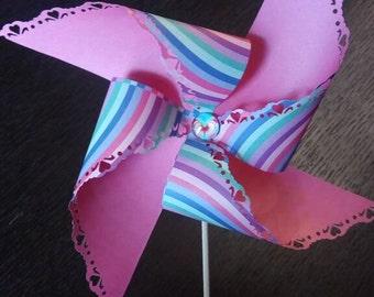 Pinwheel placeholder/paper wedding favor lace edge. Paper pinwheel place card