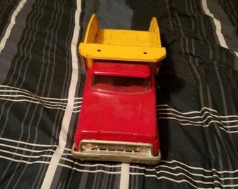 Tonka yellow and red dump truck