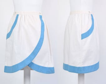 Vintage size 8 80s white wrap tulip shape mini skirt with blue trim and poppers
