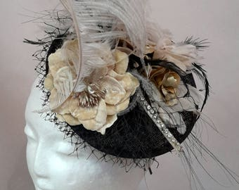 Navy and cream with flower, feather and diamontee detail Fascinator