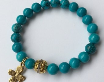 SUMMER SALE | Turquoise beaded stretch bracelet with cross charm and rhinestone focal bead