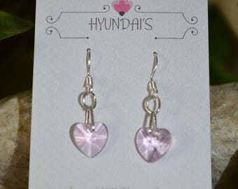 These earring's are a light baby pink glass heart,with a extra loop on a silver plated earring hook!