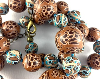 Handcrafted polymer clay necklace- turquoise and brown spots
