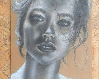Artistic portrait on wood made with charcoal and fusaggine
