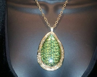 Vintage gold plated with Green paisley colored pendant