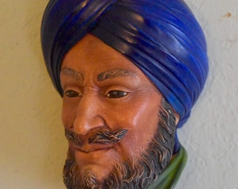 Bossons head. Sikh chalkware with blue turban and green shirt. Congleton England. Vintage 1966 wall art; decorative head.