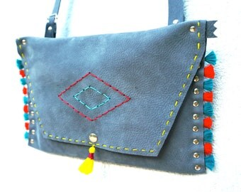 Light grey leather pouch orange and blue PomPoms
