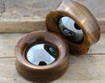 1  1/4 Genuine Lignum with Hematite Inlay.  Only pair ever made.