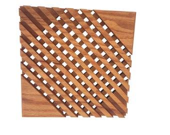 Two mid-century teak wood trivets