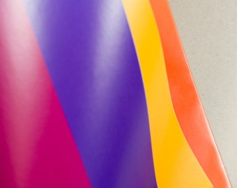 Multi-colour, striped 700mm x 500mm, gift wrapping paper in purple, red, pink, orange, yellow