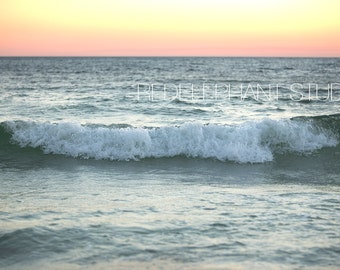 Ocean wave at Sunset by the beach with an orange sky digital background/digital backdrop