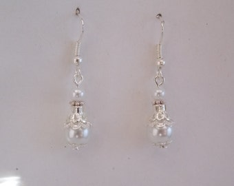 White and silver ear loop ideal for a wedding