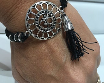 Bracelet with OM charm and tasel