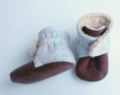 Baby booties with feather design. 6-9 months. Pale blue with orange and white. Gender neutral, perfect for a boy or girl.