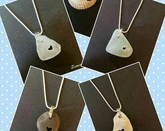 Sea glass, shell and pebble pendants.