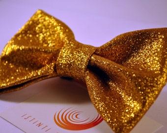 Handmade bow tie made up of golden glitter fabric