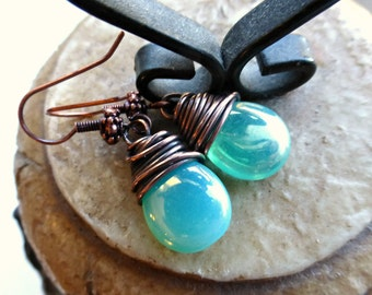 Teal green transparent Czech Picasso glass teardrop, copper wire wrapped earrings.