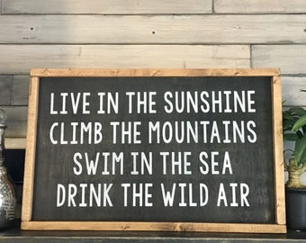 Live In The Sunshine Climb The Mountains Swim In The Sea Drink The Wild Air Wood Framed Sign