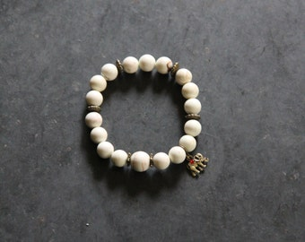 White howlite bead bracelet with elephant charm