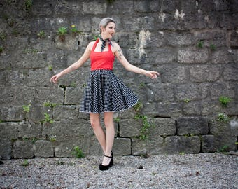 black circle skirt has white polka dots
