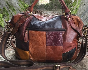 Awesome leather patchwork duffel purse.