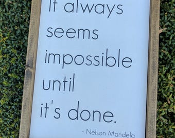 It always seems impossible until it's done. - Nelson Mandela (wood sign)