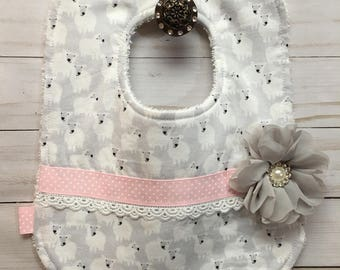 Counting Sheep Pretty. This Adorable Bib is Covered in Sheep. Has a Grey Shabby Chic Rhinestone Flower and Pink Ribbon and Lace.