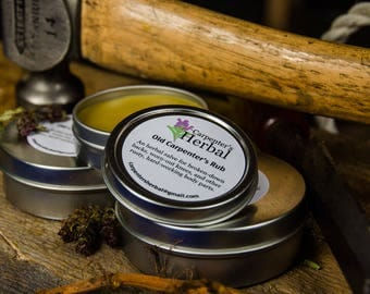 Trial Size: Old Carpenter's Rub, an herbal salve for broken-down backs, worn-out knees, and other rusty, hard-working body parts.