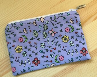 Lined Zipper Pouch in Lavender flowers print lined with pink and white polka dots