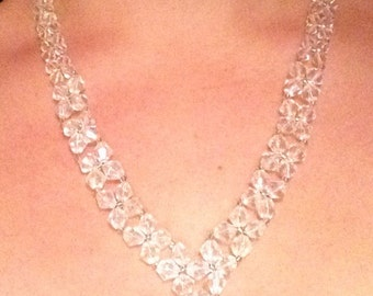"Sparkly festive graduated necklace with clear crystal bicones. Length 11"" Silver tone lobster clasp."