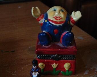 Humpty Dumpty still on his wall trinket is a soldier